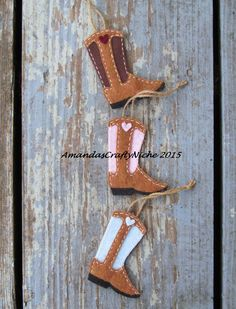 This is a custom handcut/ handstitched/ handpainted, felt cowboy boot ornament. It hangs from a piece of jute. Boot measures 3 3/4 inches tall and 2 3/4 inches wide. I welcome custom orders. When sending a request for a custom order please use details. Custom orders can take up to 3 days to make, or longer for larger orders.