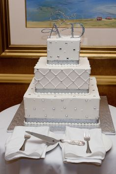 Silver and white winter wedding cake.