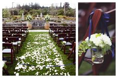 A petal flower aisle with mason jars on the chairs for accents.