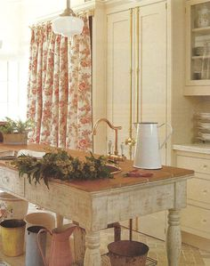 French Country farmhouse kitchen island with Herbeau Valence copper faucet.