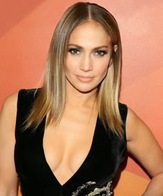 J.Lo Brought Back Her Early 2000s Side-Swept Bangs  | Jennifer Lopez brought back her side-swept bangs from the mid-2000s. Click here to see a pic of her new fringe.