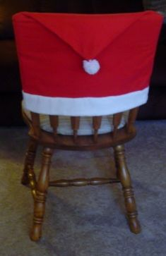 These Santa Hat Chair Covers are very inexpensive and easy to make.  They will make your dinner table look very festive for the holidays.