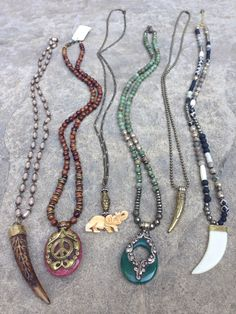 One of a kind boho necklaces with natural stones including: jasper, lava, agate, pyrite, bone. All pendants are handmade with natural materials  Prices left to right: $228,$228,$78,$248,$68,$238 Email lisajilljewelry@gmail.com if interested.