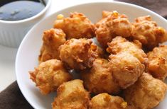 Best-ever corn fritters recipe from my Gram's kitchen to yours. They're extra yummy served with a little maple syrup for drizzling. Corn Fritter Recipes, Corn Recipes, Veggie Recipes, Great Recipes, Cooking Recipes, Favorite Recipes, Sweet Crepes Recipe, Tasty Bread Recipe, Sweet Corn Fritters