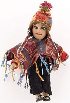 Male Doll from Chahuaytire - This doll is an exquisite example of the indigenous male dress from the CTTC-member village, Chahuaytire, in the Cusco highlands of Peru. Every detail is handmade from the woven poncho down to the beaded braids on his hat. A perfect gift for anyone who cherishes global dolls (not recommended as a toy). | Clothroads