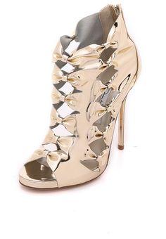Talina peep toe sandals by Oscar de la Renta. Flashing mirrored leather puts a striking finish on these bow accented Oscar de la Renta booties....