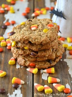 Monster Cookies   3 large eggs, 1 cup brown sugar  1 cup white sugar, 1 tsp vanilla  1 tsp corn syrup, 2 tsp baking soda  1/2 tsp salt, 1/2 cup butter, melted  1 1/2 cup peanut butter  4 1/2 cups old fashioned rolled oats  1/2 cup flour, 2/3 cup Reese's Pieces (peanut butter), 2/3 cup chocolate chips, candy corn  Preheat your oven to 350 degrees.  In a mixer combine eggs, sugars, vanilla, corn syrup, baking soda & salt. Add in peanut butter & melted butter.  Mix. Ad....