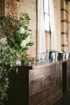 Leafy centerpiece for the bar | Photo by Cmostr Photography | Floral design by BRRCH