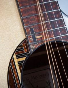 McConnell OM Acoustic Guitar... like the rosette inlay incorporated with the fretboard