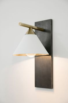 KELLY WEARSTLER | CLEO SCONCE. Sophisticated and geometric sconce in antique brass