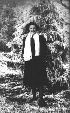 "Diana Neale nee Spence, aged 20, at Woburn Abbey, 1943, where she was billetted. ""I was called up into the WRNs at the beginning of 1943. Then I had two weeks of training at a centre in London, and was then sent to work at Bletchley Park...In Hut 4, we worked with brilliant linguists from Oxford and Cambridge. When we received the german messages which had been decoded, they translated them from German into English, and then sent these to typists be typed up."""