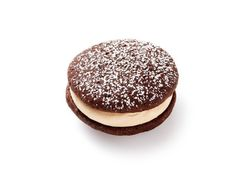 Tiramisu Sandwich Cookies : Give your friends a tiramisu to go. Sweet, coffee-flavored filling is sandwiched between two chocolate cookies for a flavor that tastes just like the Italian classic.