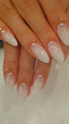 Glittery pink and white almond nails.