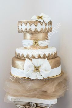 white gold fondant wedding cake with brooch and bows