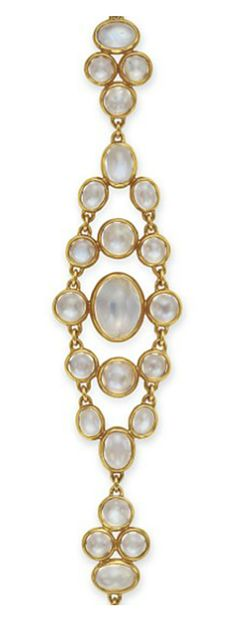 A MOONSTONE AND GOLD BRACELET, BY TIFFANY & CO.   Designed as an openwork band of cabochon moonstones, mounted in 22k gold, 7 ins.  Signed T & Co. for Tiffany & Co.