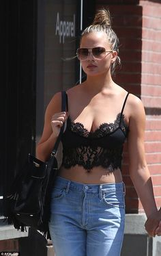 Eye-popping! Chrissy Teigen was a sight to behold as she strolled the New York City streets on Saturday in a barely-there black lace bralet and hip-hugging jeans