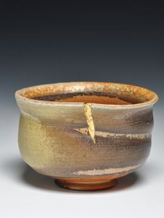 """The Japanese have a long tradition of repairing pots with gold; it's called """"kintsugi"""" or """"kintsukuroi"""".   """"When the Japanese mend broken objects, they aggrandize the damage by filling the cracks with gold. They believe that when something's suffered damage and has a history it becomes more beautiful and valuable."""""""