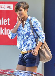 Looking good: Frankie showed off her legs again in shorts which she teamed with a Hermes belt and a busy top