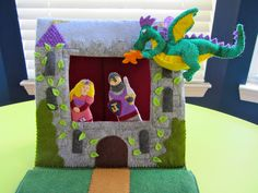 It's a quiet book page! It's a puppet theater! It's both! This page was inspired by the rich colors of wool blend felt carried by American Felt and Craft, who provided the felt for this project. (V...