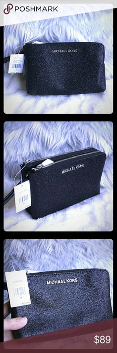 """Michael Kors Double Zip Jet Set Large Wristlet NWT Beautiful brand new with tag on! Black with silver glitter, smooth leather finish, great for everyday use or parties! Double zip Wristlet: 1zip pocket is just an open compartment; the other zip pocket has 3 card holders. Great for your cards, keys and phones. 7""""×4.5"""" ×1.75"""" Michael Kors Bags Clutches & Wristlets"""