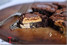 You can't resist Peanut Butter Patty Girl Scout Cookies (Tagalongs) embedded in brownies with pb chips in them!