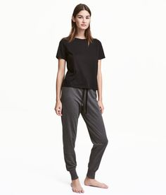 Check this out! Joggers in lightweight sweatshirt fabric with an elasticized drawstring waistband and ribbed hems. Soft, brushed inside. - Visit hm.com to see more.