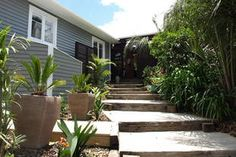 renovated 1940's state house nz - Google Search Fire Pit Table And Chairs, Outdoor Dining Chair Cushions, Outdoor Furniture, Outdoor Decor, Tommy Bahama Beach Chair, White Stool, New Builds, House Front, Porch Swing