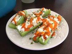Buffalo Style Stuffed Celery- Celery with light cream cheese mixed with blue cheese, drizzle with hot sauce and sprinkle with chives.