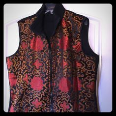 Silk fleece vest. Ladies silk front fleece vest by Invisible World in Juneau, Alaska. Black fleece with orange and red silk pattern front. Alaskan made and Asian inspired silk pattern. No trades. Invisible World Jackets & Coats Vests