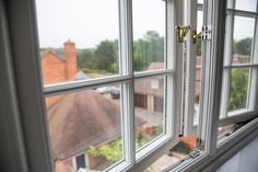 Storm 2 Timber look alike Upvc Windows viewed from inside a home.