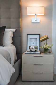 Master Bedroom details at this Center City West Residence in Philadelphia. A neutral schematic, rich with shagreen-wrapped nightstands, silk wallcoverings and deep charcoal velvet and soft linens to dress the bed. Timeless, urban elegance. Interior Designer: Cherie Stein Interiors Photo: Elena Jasic