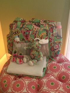Vera Bradley to Brighten Up Tots' Rooms With New Baby Collection: Mary Jane Soft Shoes ($28)  : Three-piece Layette Set, including footie, hat, and rattle ($60)  Dress and Bloomers Set in Lily Bell ($49)  : Plush Blanket in Tutti Frutti ($48)  Lovey Bunny in Tutti Frutti ($22)  Receiving Blanket in Tutti Frutti ($36)  : Make a Change Baby Bag in Lily Bell ($118)  : Convertible Baby Bag in Tutti Frutti ($109)  Bunny in Tutti Frutti ($19)