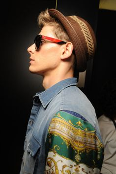 The jacket, the hat, and the glasses...
