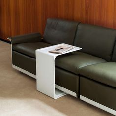 A large table can slide over most sofa seats for a convenient surface while you sit back
