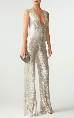 This **Naeem Khan** jumpsuit features a V-neckline, flared legs, and an all over sequin embellishment.