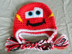Lightning McQueen crochet hat with earflaps and braids, size 2-3 T, 3-5 T, or youth, winter accessories, boy girl child. $20.00, via Etsy.