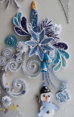 Christmas quilling. Quilling, very pretty for paper card embellishing or Christmas package embellishing. Can even make wall decorations that last if carefully glued or mounted to a firm piece of boarding. If storing put in a box that won't get crushed.