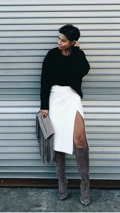 black oversize sweater + white midi skirt + taupe fringe clutch + taupe suede knee high boots