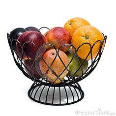 Fruit bowl on a white background containing oranges, plums, nectarines, pears, and mangos.
