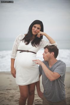 cute maternity photo, young family, white dress, beach, silly