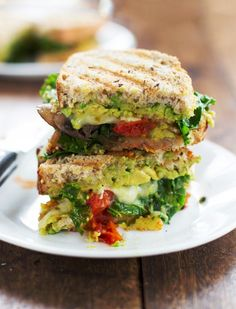 This avocado veggie panini is stuffed with lots of sauteed mushrooms, tomatoes, and kale, and smeared with avocado. 300 calories.