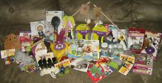 """Jack's Pets Donation Photo 4/5    Photo 4 ~ 94 Items  Play N Squeak Toy, kitty swat exerciser, 14 cat toys, 2 lazer toys, motorized mouse toy, remote controlled mouse toy, electronic motion ball, 2 cat teaser stick toys, 60 2"""" plush mice, catnip bubble shooter, catnip spray, catnip bubble twin pack, catnip bubbles, shedding blade, pin brush, my furst groomer, 2 deshedding tools (short & long hair), 2 cat nails trimmers    Thank You!!    326/900"""