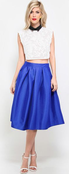 "You'll be nothing short of dazzling and ravishing in this magnificent pleated taffeta midi skirt! This gorgeous midi skirt features soft pleating around the top, fitted waistband that can be worn high waisted, hidden side zipper, slightly ruffled hemline, and is made of a taffeta material with a slight sheen to it. Skirt measures 26"" approx. from top to bottom hem and the perfect tea length!Model Measurements:Height 5'11, Bust 32"", Waist 24"", Hips 33"". She is wearing a size small."