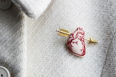 Heart & Arrow  brooch / Red embroidery and golden brass arrow. €15.00, via Etsy.