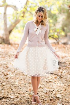 So cute... love the old look with the bow tie, cardigan and especially the elegant skirt w/ polka dots.