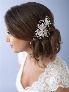 Camila Floral Bridal Comb features embellished leaves that are accented with bouquets of rhinestones. The hair clip measures approximately 5 inches x 3 inches.