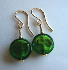 These earrings were made by threading the beads onto a headpin, then attaching the headpin to an earwire by means of a wrapped loop.
