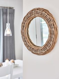 This striking round rattan mirror has a beautifully relaxed feel thanks to its textured frame.
