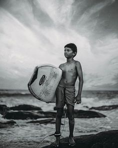 Photo by @bhumikab  Meet Tayin Santhosh's bestfriend. He's an 8 year old kid who I saw surfing on my last day down south. I immediately told Santosh( as he's teaching him how to surf) that I really want to take his portrait. Luckily the kid agreed. :) It's kind of funny but I can't wait to have kids and teach them how to surf. #villagelife  #surfing #surf #surfer #extremesport #portrait #mood #blackandwhite #everydayindia #southindia #tamilnadu #moody #love #portraitmood . . . #visual…