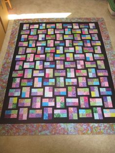 gemstones jelly roll quilt... done for Paige's graduation
